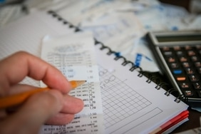 Bookkeeper filing Receipts